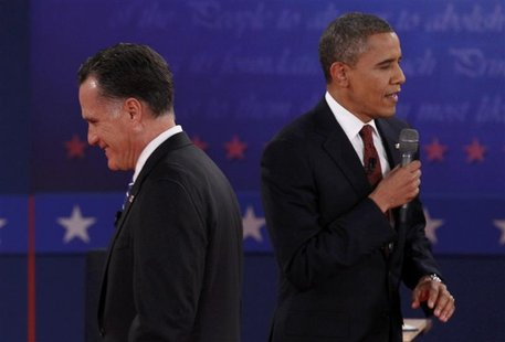 Republican presidential nominee Mitt Romney (L) listens to U.S. President Barack Obama during the second U.S. presidential campaign debate i