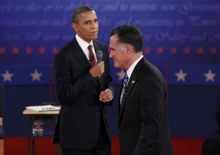 U.S. President Barack Obama (L) looks over at Republican presidential nominee Mitt Romney during the second U.S. presidential campaign debat