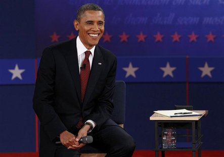 U.S. President Barack Obama listens during the second presidential debate with Republican presidential nominee Mitt Romney (Not Pictured) in