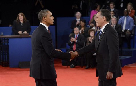 U.S. Republican presidential nominee Mitt Romney (R) shakes hands with President Barack Obama at the conclusion of the U.S. Republican presi