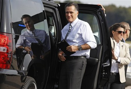 U.S. Republican presidential nominee and former Massachusetts Governor Mitt Romney boards his campaign plane in Norfolk, Virginia, October 1