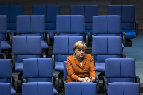 German Chancellor Angela Merkel attends a debate after delivering a government policy statement during a session of the Bundestag, the Germa