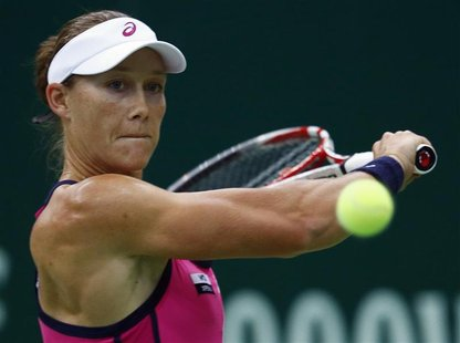 Australia's Samantha Stosur hits a return against France's Alize Cornet during their Kremlin Cup tennis match in Moscow October 18, 2012. RE