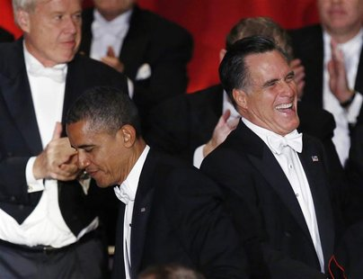 U.S. President Barack Obama and Republican presidential candidate Mitt Romney (R) are pictured on stage at the 67th Annual Alfred E. Smith M