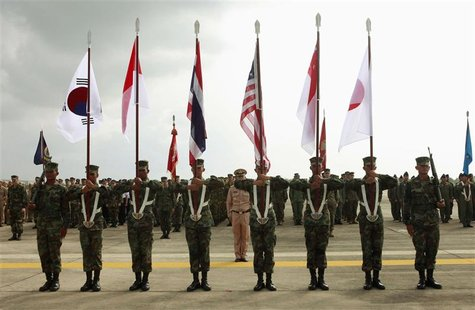 "Thai soldiers carry national flags as they participate in the opening ceremony of the annual joint ""Cobra Gold 2010"" (CG10) military exercis"