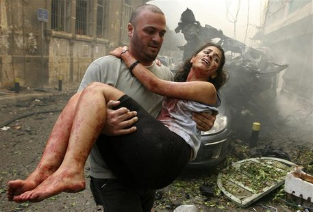 A wounded woman is carried at the site of an explosion in Ashrafieh, central Beirut, October 19, 2012. At least two people were killed and 1