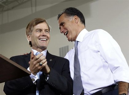 U.S. Republican presidential candidate Mitt Romney speaks to Virginia Governor Bob McDonnell (L) at an election rally in Sterling, Virginia,