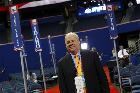 Republican political strategist Karl Rove walks the floor of the Republican National Convention before the start of first session of the con