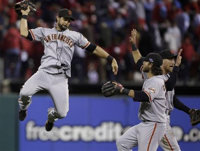 San Francisco Giants center fielder Angel Pagan celebrates with teammates Brandon Crawford and Hunter Pence (R) after their team defeated th