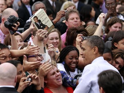 "A copy of U.S. President Barack Obama's book ""The Audacity of Hope"" is held by a supporter looking for an autograph during a campaign rally"