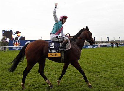 Tom Quealy on Frankel celebrates after winning The Champion Stakes during the British Champions Day at Ascot racecourse in southern England