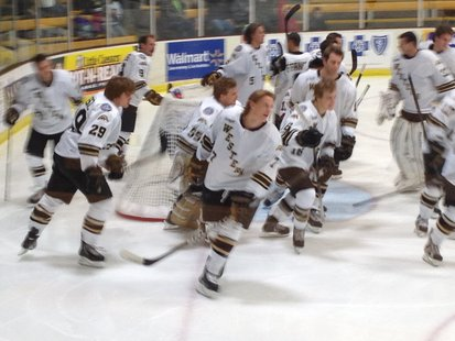 Western Michigan Broncos hockey team skates back to the bench following their warm up session.