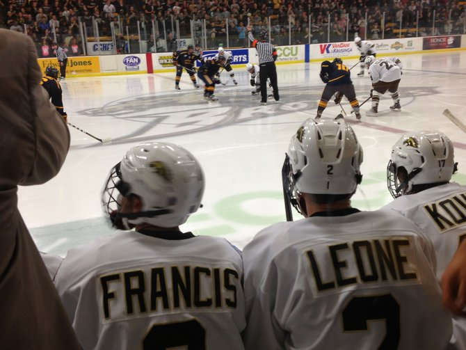 Western Michigan hockey players Robert Francis and Mike Leone look on as the puck drops against the Canisius Golden Griffins Saturday 10/20/2012 at Lawson Ice Arena