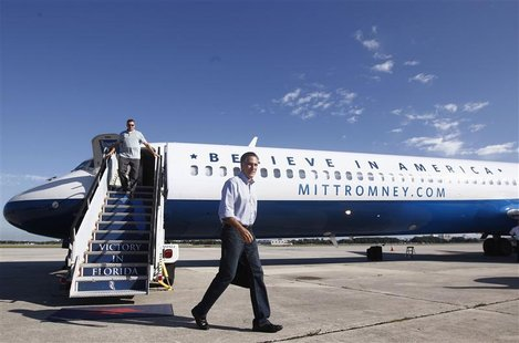 U.S. Republican presidential nominee and former Massachusetts Governor Mitt Romney steps off his campaign plane in West Palm Beach, Florida,