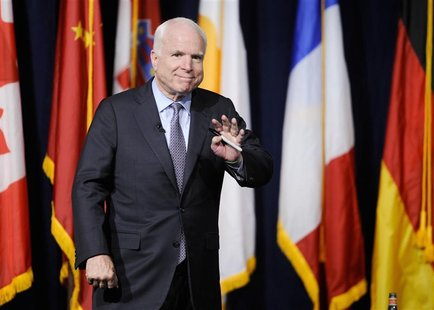 Senator John McCain takes the stage during the University of Southern California's Schwarzenegger Institute for State and Global Policy inau