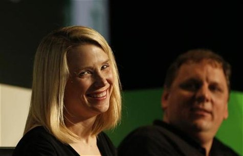 Yahoo! Chief Executive Marissa Mayer (L) smiles a Startup Battlefield session at TechCrunch Disrupt SF 2012 at the San Francisco Design Cent
