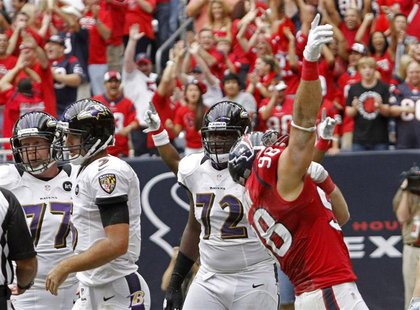 Houston Texans linebacker Connor Barwin (98) celebrates after sacking Baltimore Ravens quarterback Joe Flacco (L) in the end zone for a safe