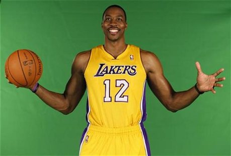 New center Dwight Howard poses for photos during NBA media day for the Los Angeles Lakers basketball team in Los Angeles October 1, 2012. RE