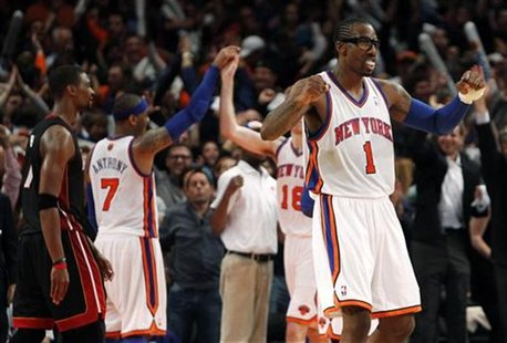 New York Knicks' Amar'e Stoudemire (1) celebrates after the Knicks defeated the Miami Heat in Game 4 of their NBA Eastern Conference basketb