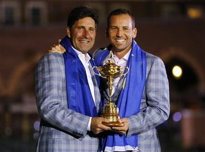 Team Europe golfer Sergio Garcia (R) of Spain holds the Ryder Cup with captain Jose Maria Olazabal after the closing ceremony of the 39th Ry