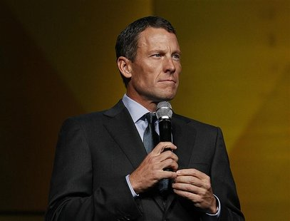 Lance Armstrong makes an appearance at the LIVESTRONG's 15th anniversary gala, his cancer-fighting charity in Austin, Texas, October 19, 201