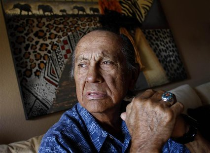 American Indian activist Russell Means poses for a portrait at his home in Scottsdale, Arizona, in this October 28, 2011 file photo. REUTERS