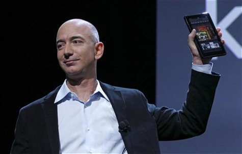 Amazon CEO Jeff Bezos holds up the new Kindle Fire at a news conference during the launch of Amazon's new tablets in New York, September 28,