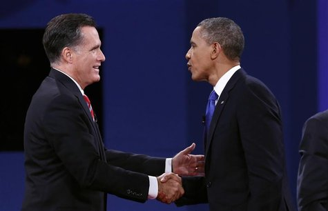 U.S. President Barack Obama (R) and Republican Presidential nominee Mitt Romney shake hands at the conclusion of the final presidential deba