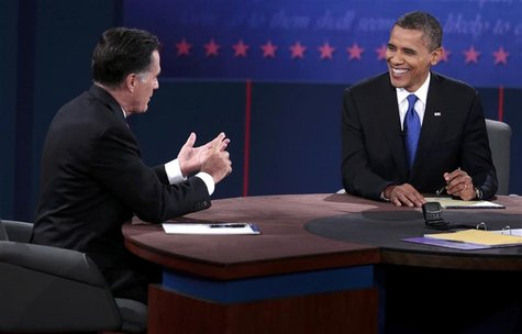 U.S. Republican presidential nominee Mitt Romney (L) makes a point as U.S. President Barack Obama smiles during the final U.S. presidential