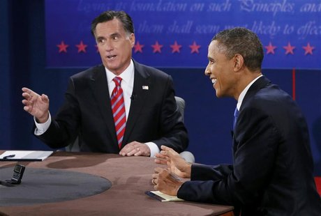 U.S. President Barack Obama (R) laughs as Republican presidential nominee Mitt Romney speaks during the final U.S. presidential debate in Bo