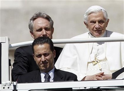 The Pope's butler, Paolo Gabriele (bottom L) arrives with Pope Benedict XVI (R) at St. Peter's Square in Vatican, in this file photo taken M