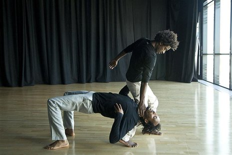 Ethiopian dancers Addisu Demissie and Junaid Jemal Sendi (R) rehearse at a studio in London September 5, 2012. The duo will perform on Octob