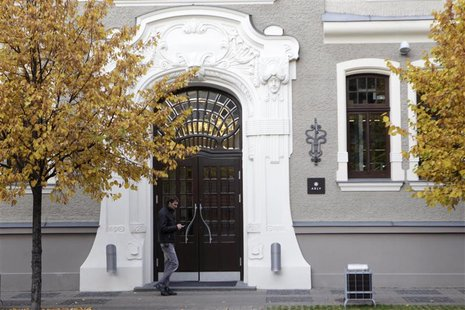 People walk past an ABLV Bank office in Riga October 23, 2012. REUTERS/Ints Kalnins