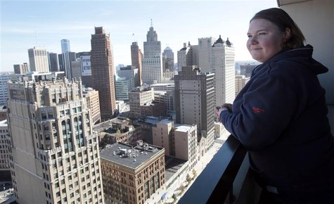 Jeanette Pierce stands on an outside balcony in the high-rise apartment building she lives in downtown Detroit, Michigan on October 16, 2012