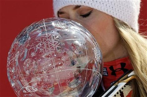 Lindsey Vonn from the U.S. kisses her trophy after winning the women's overall World Cup at the Alpine skiing World Cup finals in Schladming