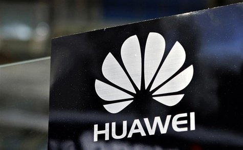 A Huawei logo is seen above the company's exhibition pavilion during the CommunicAsia information and communications technology trade show i