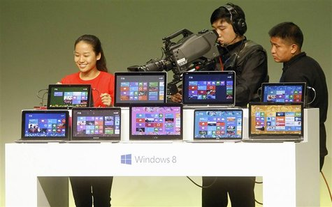 A student shares her experience of using Windows 8 as she speaks to the media during a Microsoft promotional event ahead of the launch of Wi