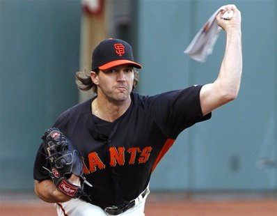 San Francisco Giants starting pitcher Barry Zito warms-up his arm with a towel during practice for the MLB World Series in San Francisco, Oc