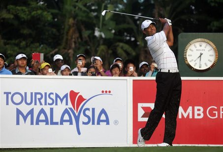 Tiger Woods of the U.S. watches his first shot on the first hole during the Pro-Am ahead of the Malaysia's Asia Pacific Classic golf tournam