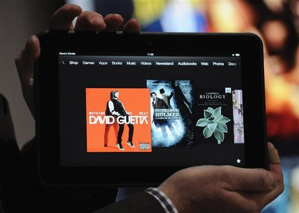 "An employee demonstrates the new Kindle Fire HD 8.9"" at Amazon's Kindle Fire event in Santa Monica, California September 6, 2012. REUTERS/Gu"
