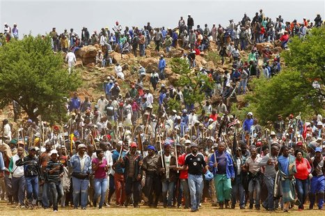 Striking miners chant slogans as they gather at the AngloGold Ashanti mine in Carletonville, northwest of Johannesburg October 24, 2012. Ang