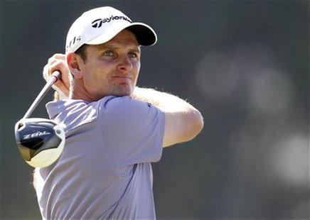 Justin Rose of England tees off on the 12th hole during the final match of World Golf Final against Lee Westwood of England in Antalya, sout