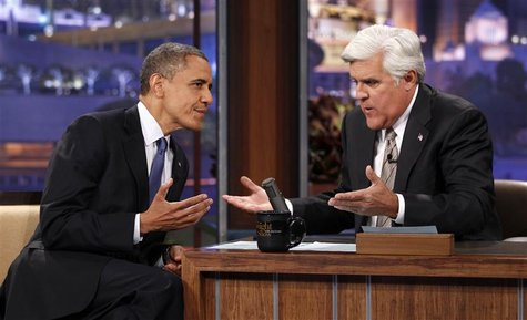 U.S. President Barack Obama speaks to host Jay Leno (R) as he makes an appearance on the Tonight Show in Los Angeles, California October 24,