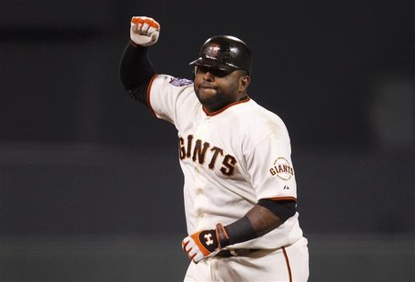 San Francisco Giants' Pablo Sandoval celebrates his third home run of the game against the Detroit Tigers in the fifth inning during Game 1