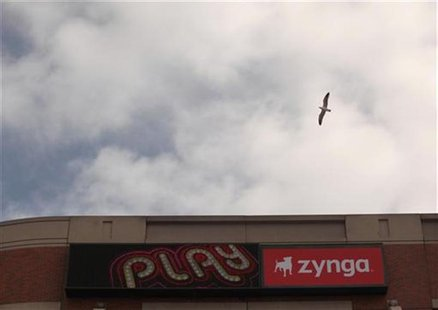 A bird flies above the corporate headquarters of Zynga Inc, the social network game development company, in San Francisco, California April
