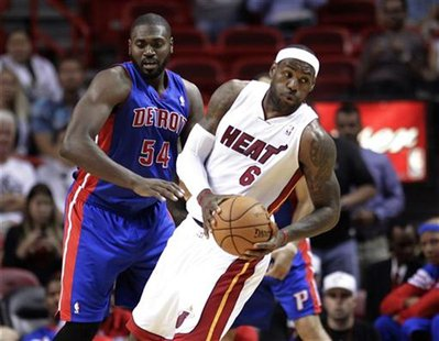Detroit Pistons' Jason Maxiell (L) clashes with Miami Heat's LeBron James in a preseason NBA basketball game at the Miami Heat's home arena