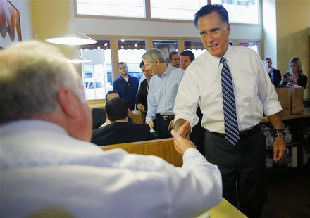 Republican presidential nominee Mitt Romney greets diners at First Watch cafe, where he picked up some food, in Cincinnati, Ohio October 25,