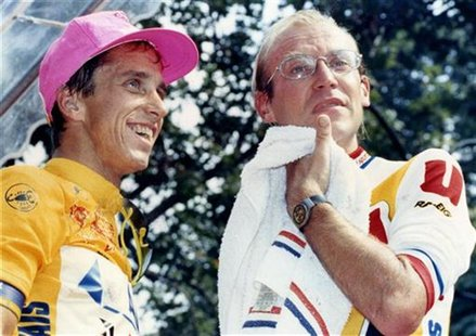 Greg LeMond of the U.S. (L) and Tour de France leader Laurent Fignon of France stand on the podium at the end of the Tour de France cycling