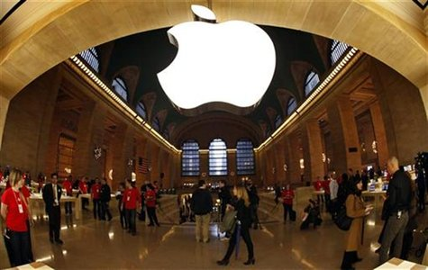 The Apple Inc. logo hangs inside the newest Apple Store in New York City's Grand Central Station December 7, 2011, during a press preview of