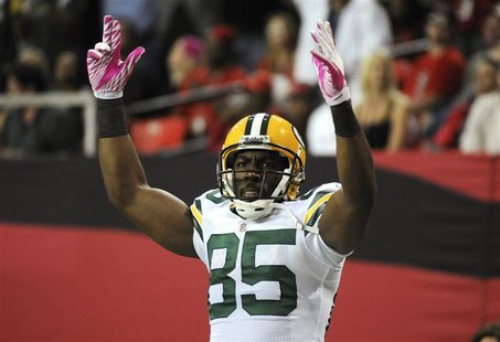 Green Bay Packers' wide receiver Greg Jennings celebrates a touchdown in the second half of their NFL football game against the Atlanta Falc